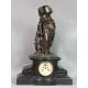 Zegar z Panią z dzieckiem. 45cm x 64cm x 22cm